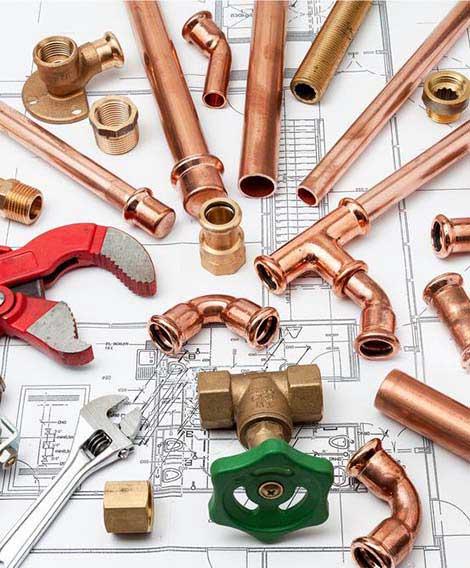 470*568 tuyaux et coude en cuivre utilisés par plombier79 pour le dépannage d'un wc à Niort